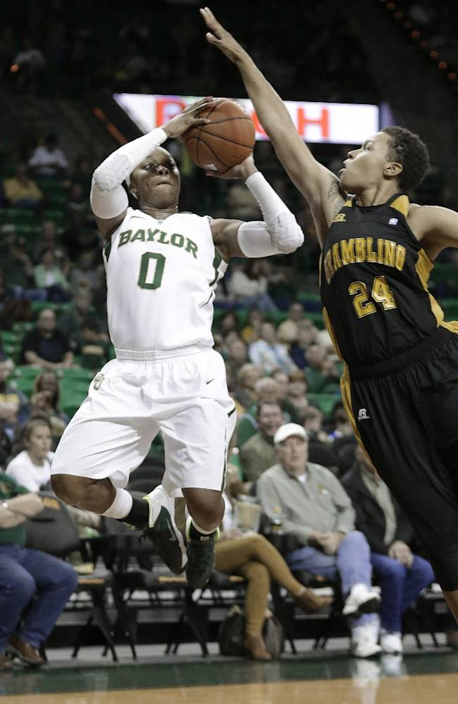 Baylor guard Odyssey Sims (0) shoots against Grambling State forward Jessica Watkins (24) during the first half of an NCAA college basketball game Saturday, Nov. 9, 2013, in Waco, Texas