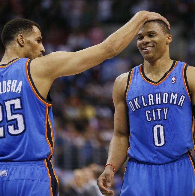 Oklahoma City Thunder guard Thabo Sefolosha, left, puts his hand on the head of guard Russell Westbrook, right, after Westbrook made one of two free throws late in the fourth quarter against the Los Angeles Clippers during the first half of an NBA basketball game in Los Angeles, Wednesday, April 9, 2014. The Thunder won 107-101