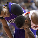Sacramento Kings' Rudy Gay, left, shares a joke with Toronto Raptors' Amir Johnson during first half NBA basketball action in Toronto on Friday March 7, 2014 The Associated Press