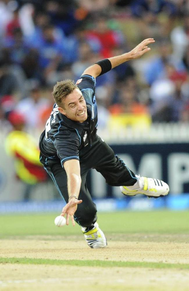 New Zealand's Tim Southee attempts a diving caught and bowled off the batting of India's Virat Kohli during their second one-day international cricket match, at Seddon Park, in Hamilton, New Zealand, Wednesday,  Jan. 22, 2014