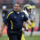 Michigan head coach Brady Hoke watches warmups before an NCAA college football game against Ohio State Saturday, Nov. 24, 2012, in Columbus, Ohio. (AP Photo/Mark Duncan)