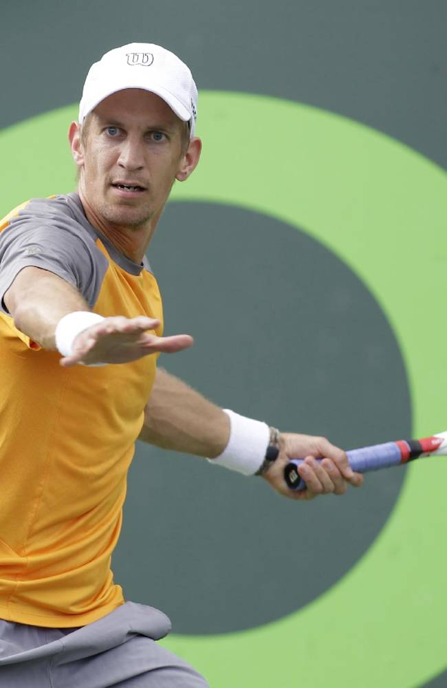 Jarkko Nieminen, of Finland,  returns the ball to Alexandr Dolgopolov, of Ukraine, during the Sony Open tennis tournament, Saturday, March 22, 2014, in Key Biscayne, Fla