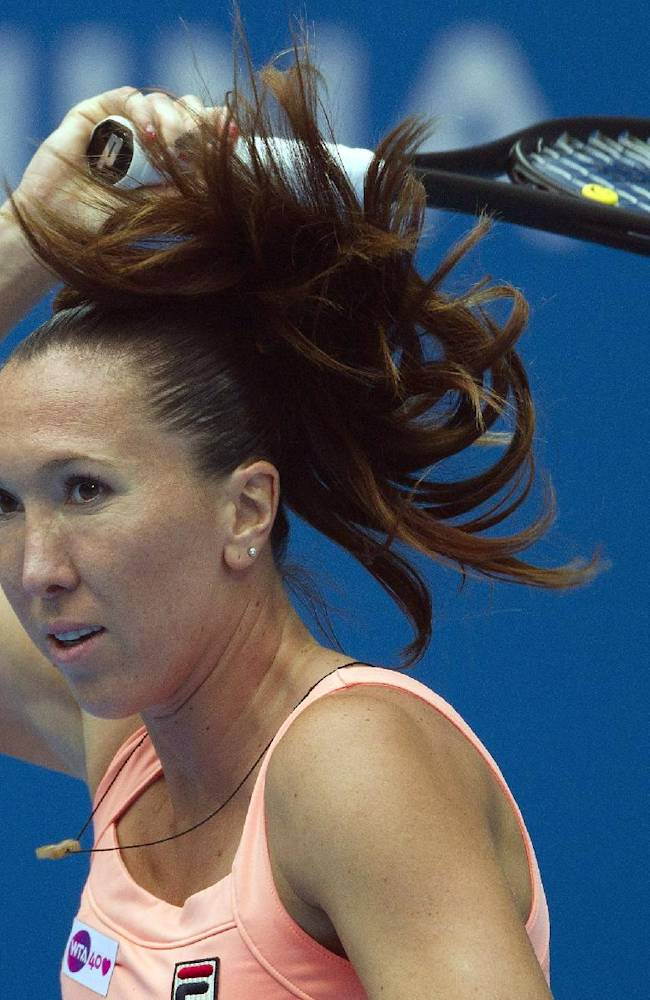 Jelena Jankovic of Serbia watches her shot as she plays against Petra Kvitova of the Czech Republic during the semifinal match of the China Open tennis tournament at the National Tennis Stadium in Beijing, China Saturday, Oct. 5, 2013