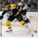 Boston Bruins defenseman Zdeno Chara (33) keeps Buffalo Sabres' Brian Flynn away from the puck during the first period of an NHL hockey game in Boston, Saturday, Dec. 21, 2013. (AP Photo/Winslow Townson)