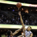 Georgetown forward Otto Porter Jr., right, shoots against Rutgers forward Kadeem Jack, left, during the second half of an NCAA college basketball game on Saturday, March 2, 2013, in Washington. Georgetown won 64-51. (AP Photo/Nick Wass)