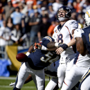 Denver Broncos quarterback Peyton Manning, right, is sacked by San Diego Chargers outside linebacker Melvin Ingram during the first half of an NFL football game Sunday, Dec. 14, 2014, in San Diego The Associated Press