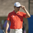 Sang-Moon Bae, of South Korea, tips his cap to the gallery on the ninth green during the first round of the Sony Open golf tournament on Thursday, Jan. 9, 2014, in Honolulu. (AP Photo/Marco Garcia)