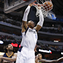 Dallas Mavericks small forward Shawn Marion (0) dunks the ball in front of Indiana Pacers' Luis Scola (4), of Argentina, and George Hill (3) during the first half of an NBA game, Sunday, March 9, 2014, in Dallas, Texas The Associated Press
