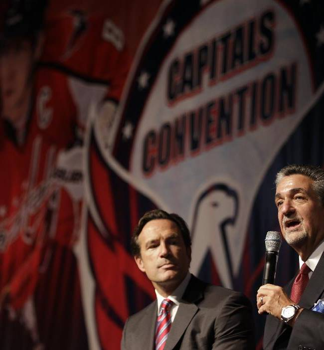 Washington Capitals majority owner Ted Leonsis, right, speaks as NHL Chief Operating Officer John Collins, left, looks on during the team's Capitals Convention, Saturday, Sept. 21, 2013, in Washington. Leonsis announced that the team will host the league's annual Winter Classic outdoor hockey game on New Year's Day in 2015