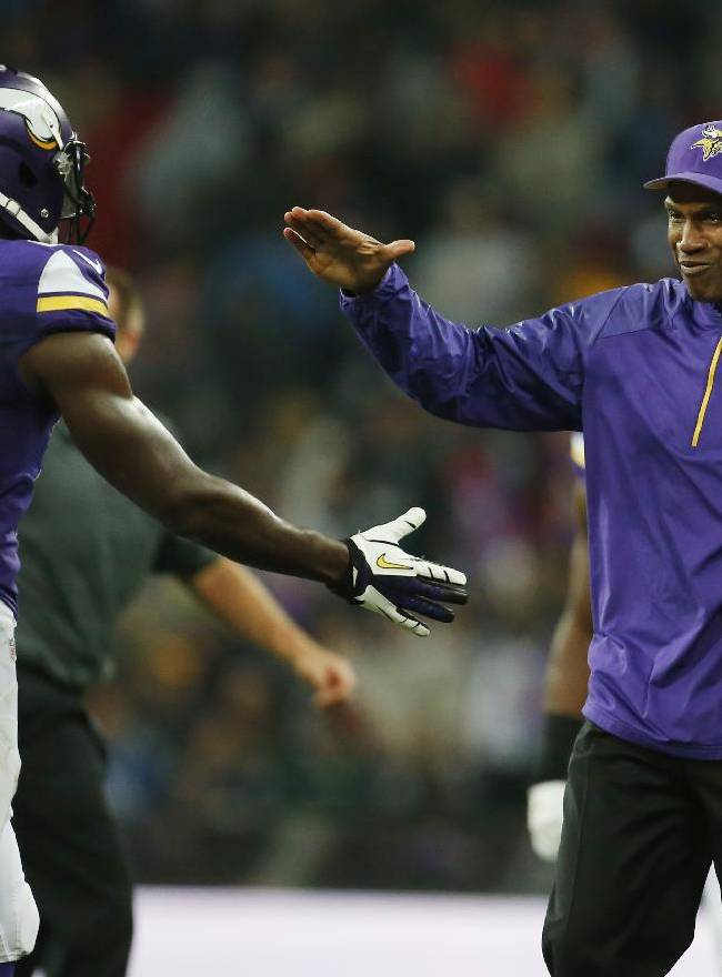 Minnesota Vikings head coach Leslie Frazier congratulates Minnesota Vikings cornerback Xavier Rhodes (29) following their NFL football game against the Pittsburgh Steelers at Wembley Stadium, London, Sunday,Sept. 29, 2013. The Vikings defeated the Steelers 34-27