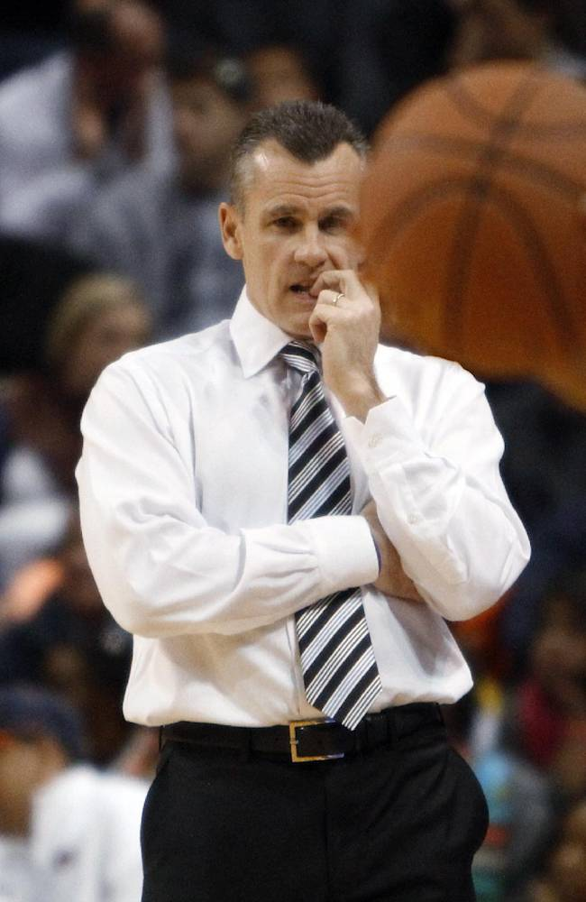 Florida coach Billy Donovan watches the second half of his team's game against Auburn in an NCAA college basketball game in Auburn, Ala., Saturday, Jan. 18, 2014