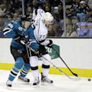 San Jose Sharks' Tomas Hertl (48), left, of Czech Republic, battles against Los Angeles Kings' Jeff Carter (77) during the first period of an NHL hockey game on Wednesday, Nov. 27, 2013, in San Jose, Calif The Associated Press