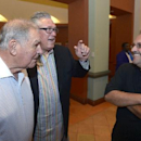 Former Atlanta Braves manager Bobby Cox, left, Pittsburgh Pirates manager Clint Hurdle, center, and former Orlando Magic head basketball coach Stan Van Gundy share a laugh at Baseball's winter meetings in Lake Buena Vista, Fla., Tuesday, Dec. 10, 2013. Co