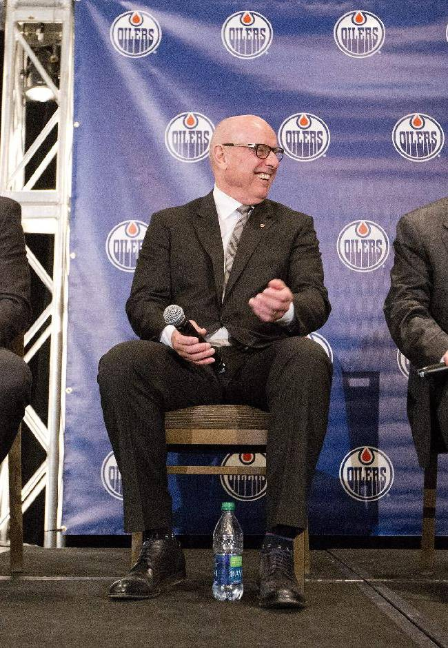 Edmonton Oliers vice-chairman Kevin Lowe, left, president and chief operating officer Patrick Laforge, center, and Bob Nicholson, the new vice-chairman of New Sports & Entertainment Company, hold a news conference to introduce Nicholson, Friday June 13, 2014 in Edmonton, Alberta