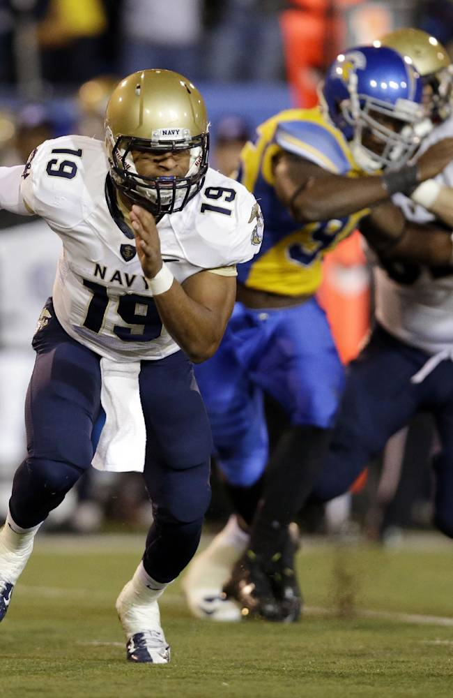 Navy quarterback Keenan Reynolds scrambles out of the pocket against San Jose State during the first half of an NCAA college football game on Friday, Nov. 22, 2013, in San Jose, Calif