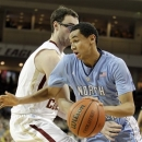North Carolina's Marcus Paige (5) drives against Boston College's Andrew Van Nest (15) during the first half of an NCAA college basketball game in Boston, Tuesday, Jan. 29, 2013. (AP Photo/Mary Schwalm)