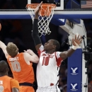 Syracuse's Trevor Cooney (10) drives past Louisville's Gorgui Dieng (10) during the first half of an NCAA college basketball championship game at the Big East Conference tournament Saturday, March 16, 2013, in New York. (AP Photo/Frank Franklin II)