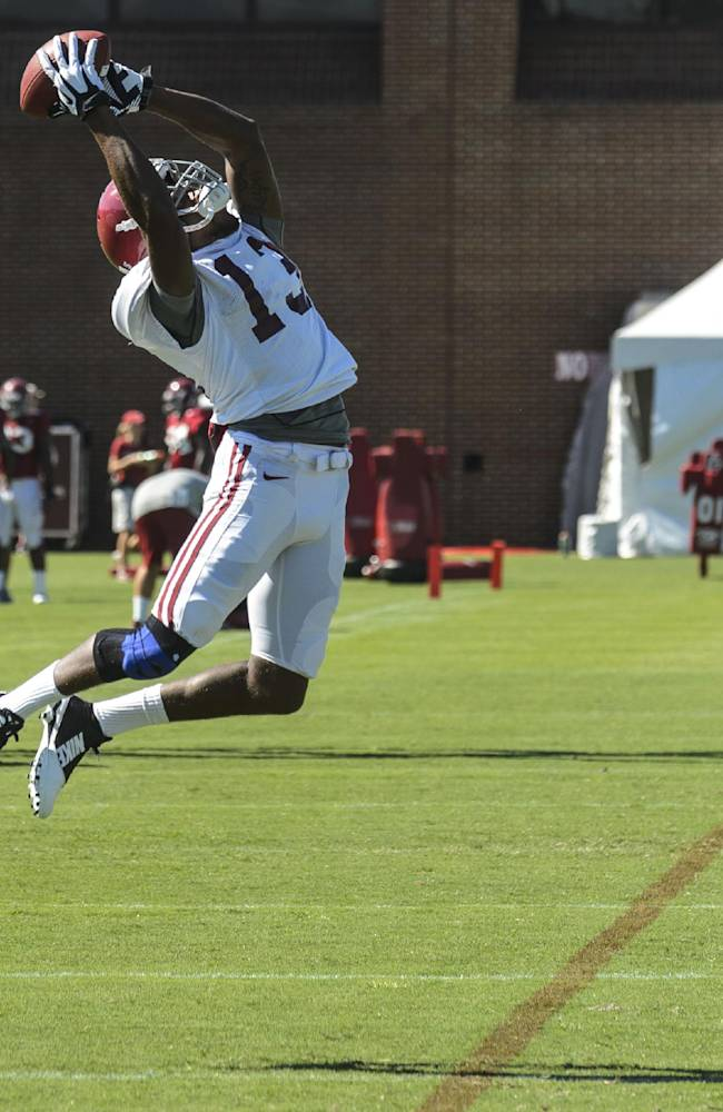 Alabama wide receiver ArDarius Stewart (13) works through passing drills at an NCAA college football practice in Tuscaloosa, Ala., Wednesday, Aug. 13, 2014