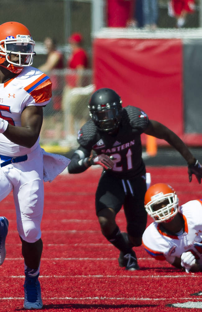 Sam Houston State quarterback Jared Johnson (15) runs 53-yards for a touchdown against Eastern Washington in the first half of an NCAA college football game in Cheney, Wash., Saturday, Aug. 23, 2014
