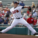 Atlanta Braves starting pitcher Kris Medlen (54) throws in the first inning of a spring exhibition baseball game against the Washington Nationals, Tuesday, March 4, 2014, in Kissimmee, Fla. (AP Photo/Alex Brandon)