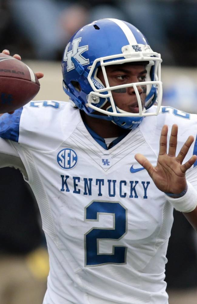 Kentucky quarterback Jalen Whitlow passes against Vanderbilt in the second quarter of an NCAA college football game on Saturday, Nov. 16, 2013, in Nashville, Tenn