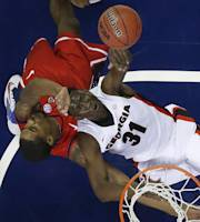 Georgia forward Brandon Morris (31) shoots on Mississippi forward Aaron Jones (34) during the first half of an NCAA college basketball game in the quarterfinal round of the Southeastern Conference men's tournament, Friday, March 14, 2014, in Atlanta. (AP Photo/John Bazemore)