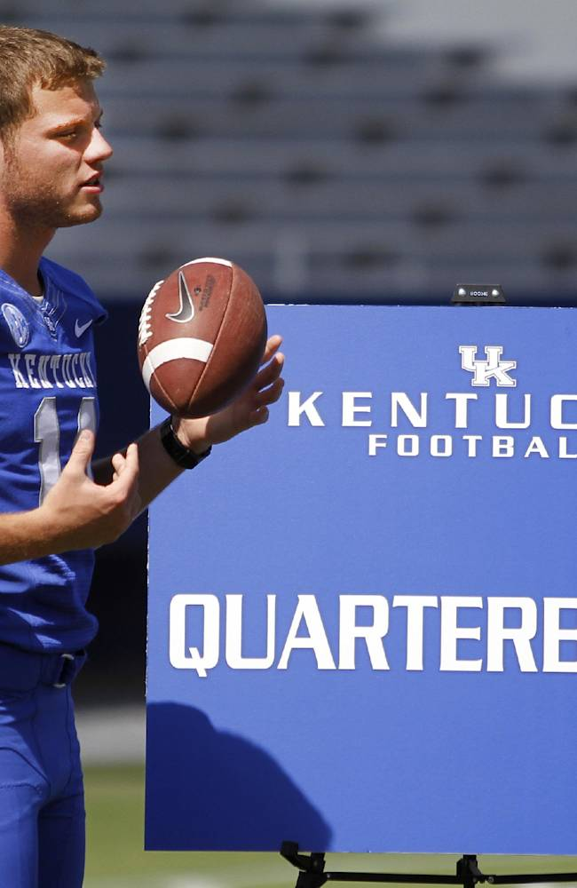 In this Aug. 5, 2013, file photo, Kentucky NCAA college football quarterback Patrick Towles waits to be interviewed during media day at Commonwealth Stadium in Lexington, Ky. Kentucky coach Mark Stoops has announced that Towles will be the Wildcats' starting quarterback this season. Stoops tweeted out his decision before Monday's Aug. 18, 2014, practice, saying,