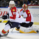 Florida Panthers left winger Sean Bergenheim (20), of Finland, reacts to an incoming shot along with goaltender Roberto Luongo (1) during the first period of an NHL hockey game against the Buffalo Sabres, Friday, Oct., 17, 2014, in Buffalo, N.Y The Assoc