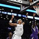 Brooklyn Nets' Paul Pierce (34) reaches for a loose ball with Sacramento Kings' Jason Thompson (34) in the first half of an NBA basketball game on Sunday, March 9, 2014, at Barclays Center in New York. Pierce left the game with an injury The Associated Pr