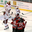 New Jersey Devils players celebrate a goal by Adam Henrique against the Phoenix Coyotes during the third period of an NHL hockey game, Thursday, March 27, 2014, in Newark, N.J. The Coyotes won 3-2 in a shootout The Associated Press