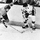 In this Jan. 22, 1975, file photo, Carol Vadnais (10) of the Prince of Wales division, battles for possession with Bobby Clarke (16) of the Clarence Campbell division during the annual All-Star contest in Montreal. Vadnais, a six-time all-star, has died.