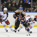 New York Islanders' Casey Cizikas (53) drives the puck down ice away from Columbus Blue Jackets' Derek MacKenzie (24) and Matt Calvert (11)' in the second period of an NHL hockey game, Sunday, March 23, 2014, in Uniondale, N.Y The Associated Press