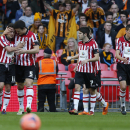 Sheffield United's Jose Baxter, left, celebrates his goal against Hull City with teammates during their English FA Cup semifinal soccer match at Wembley Stadium in London, Sunday, April 13, 2014
