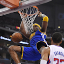 Golden State Warriors center Jermaine O'Neal, top, dunks as Los Angeles Clippers forward Danny Granger looks on during the second half in Game 1 of an opening-round NBA basketball playoff series, Saturday, April 19, 2014, in Los Angeles. The Warriors won