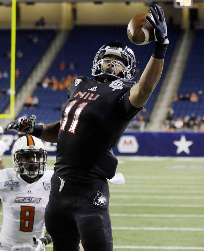 Northern Illinois wide receiver Juwan Brescacin (11) reaches for a 14-yard reception for a touchdown during the first quarter of an NCAA college football game against Bowling Green at the Mid-American Conference championship in Detroit, Friday, Dec. 6, 2013