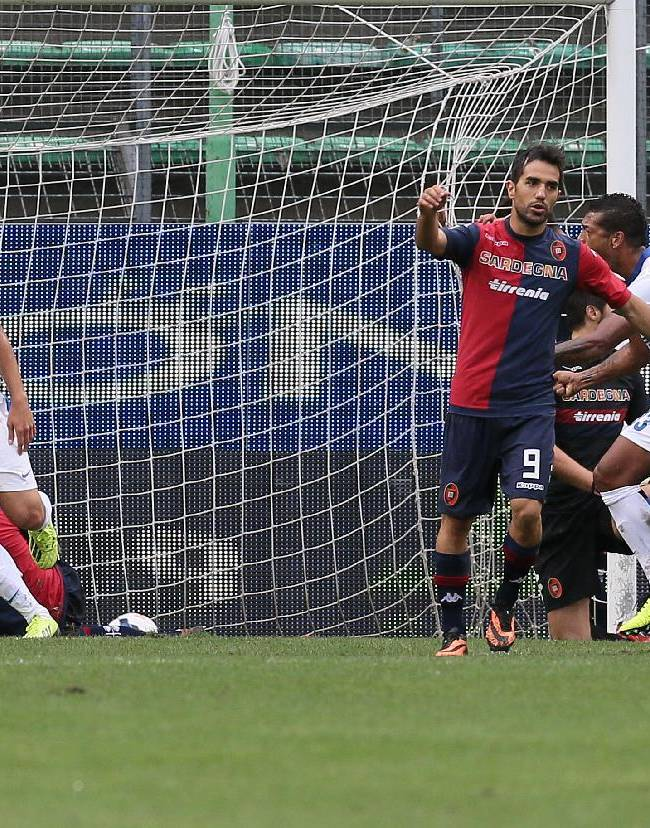 Inter's Mauro Icardi, left, celebrates after scoring during the Serie A soccer match between Cagliari and Inter Milan, at the Nereo Rocco Stadium in Trieste, Italy, Sunday, Sept. 29, 2013