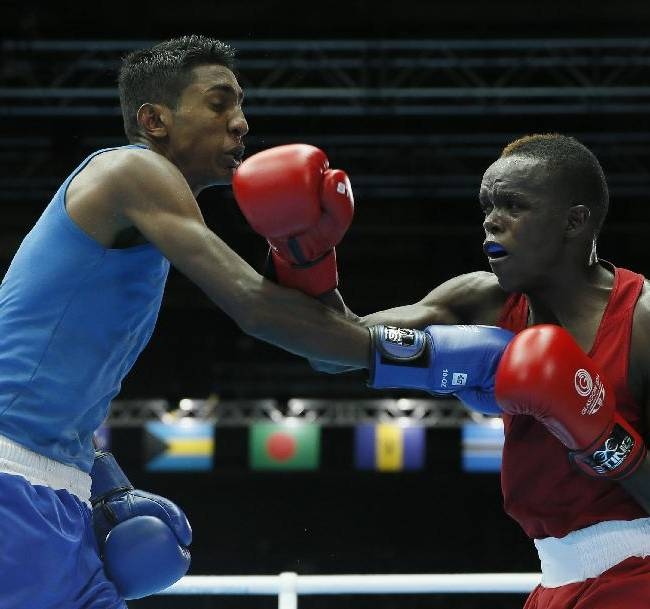 Benson Gicharu Njangiru of Kenya, right punches Imran Khan of Guyana during their men's bantam weight (56kg) boxing bout at the Commonwealth Games Glasgow 2014, in Glasgow, Scotland, Friday, July, 25, 2014