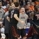 Louisville players react after Luke Hancock, foreground, scored against Syracuse during the second half of an NCAA college basketball game in Syracuse, N.Y., Saturday, March 2, 2013. Louisville won 58-53. (AP Photo/Kevin Rivoli)