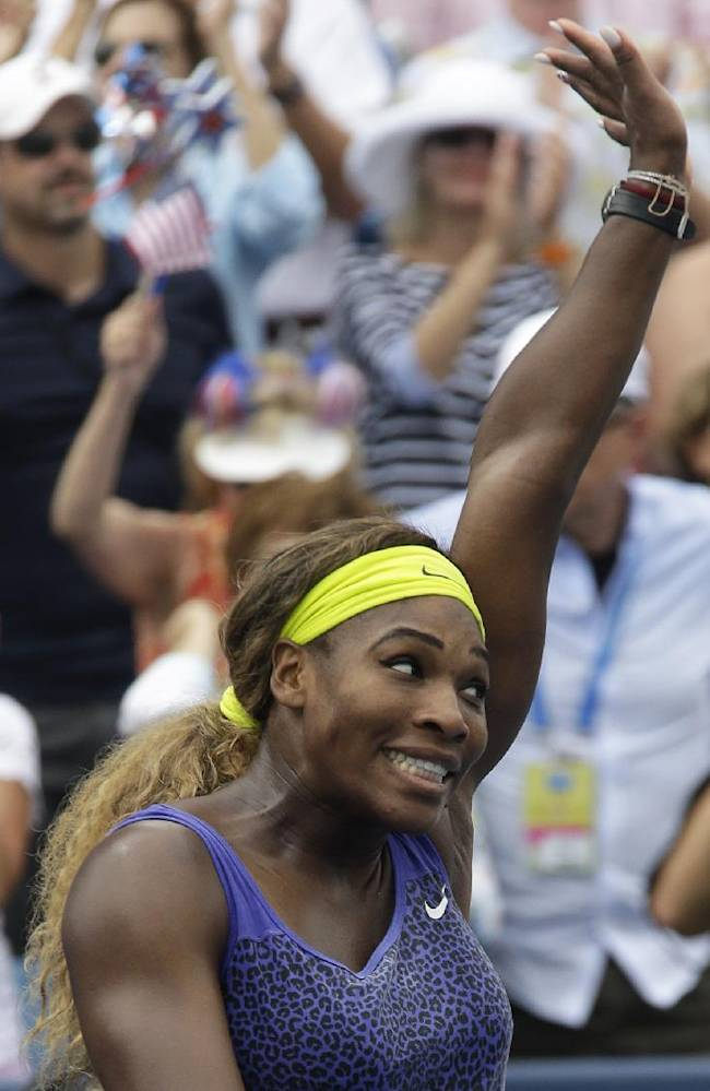 Serena Williams acknowledges the crowd after defeating Ana Ivanovic, from Serbia, 6-4, 6-1, in a final match at the Western & Southern Open tennis tournament, Sunday, Aug. 17, 2014, in Mason, Ohio