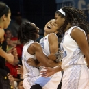 North Carolina's Latifah Coleman, second from right, celebrates her 3-pointer with Danielle Butts, second from left, and Tierra Ruffin-Pratt, right, near Maryland's Chloe Pavlech, left, during the second half of an NCAA college basketball game in Chapel Hill, N.C., Thursday, Jan. 3, 2013. North Carolina won 60-57. (AP Photo/Ted Richardson)