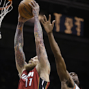 Miami Heat's Chris Andersen, left, dunks next to Milwaukee Bucks' Ekpe Udoh during the first half of an NBA basketball game Saturday, March 29, 2014, in Milwaukee The Associated Press