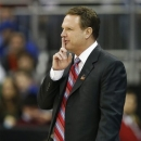 Kansas head coach Bill Self signals his team during the first half of a third-round game against North Carolina in the NCAA college basketball tournament at the Sprint Center in Kansas City, Mo., Sunday, March 24, 2013. (AP Photo/Orlin Wagner)