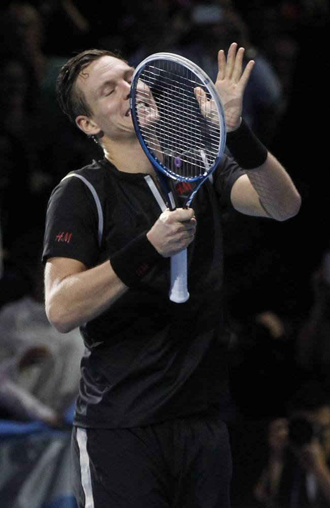 Tomas Berdych of Czech Republic celebrates his win against David Ferrer of Spain at the end of their ATP World Tour Finals single tennis match at the O2 Arena in London Wednesday, Nov. 6, 2013