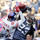 In this Nov. 27, 2005 file photo, Seattle Seahawks' Marcus Trufant (23) knocks a third-down pass away from New York Giants' Amani Toomer in the first half of an NFL football game in Seattle. The Seahawks have signed former cornerback Marcus Trufant, who i