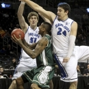 CORRECTS BYLINE - Saint Louis' Rob Loe (51) and Cody Ellis (24) block Chris Braswell during the first half of an NCAA college basketball game at the Atlantic 10 Conference, Friday, March 15, 2013, in New York. (AP Photo/Mary Altaffer)