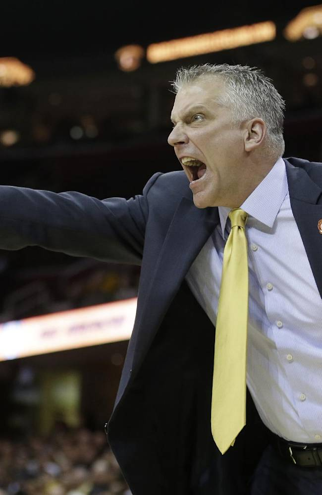 Toledo head coach Tod Kowalczyk yells to his team during the first half of an NCAA college basketball championship game at the Mid-American Conference tournament on Saturday, March 15, 2014, in Cleveland. Western Michigan defeated Toledo 98-77