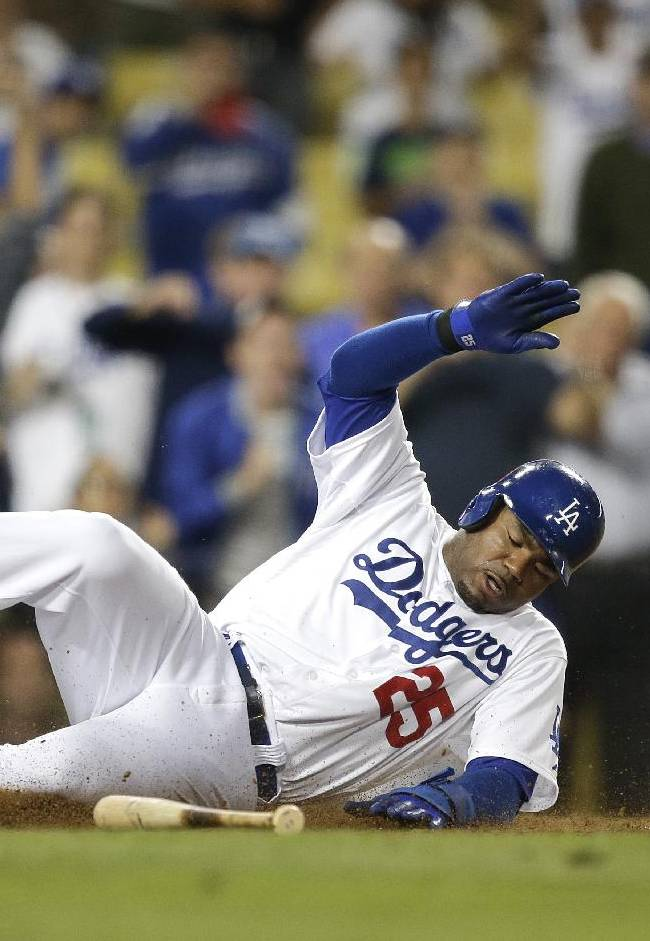 Los Angeles Dodgers' Carl Crawford scores on a walk-off single by Adrian Gonzalez during the 10th inning of a baseball game against the San Francisco Giants on Thursday, Sept. 12, 2013, in Los Angeles. The Dodgers won 3-2