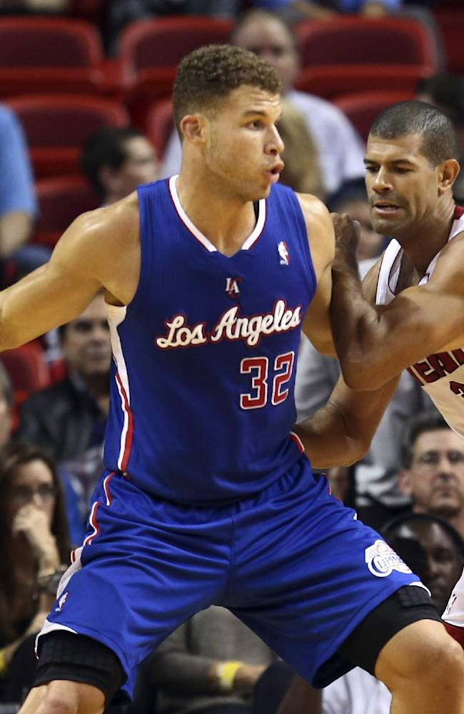 Miami Heat's Shane Battier (31) blocks Los Angeles Clippers' Blake Griffin (32) during the first half of an NBA basketball game in Miami, Thursday, Nov. 7, 2013