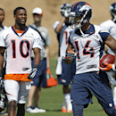 In this June 16, 2014 file photo, Denver Broncos wide receiver Emmanuel Sanders (10) calls out to wide receiver Cody Latimer (14) during an NFL football organized team activity at the team's training facility in Englewood, Colo. After throwing for more ya