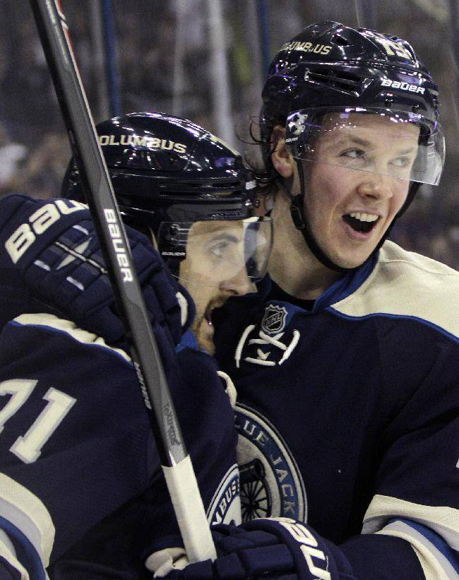 Columbus Blue Jackets' Nick Foligno, left, celebrates his goal against the Florida Panthers with teammate Ryan Johansen during the second period of an NHL hockey game on Saturday, Feb. 1, 2014, in Columbus, Ohio